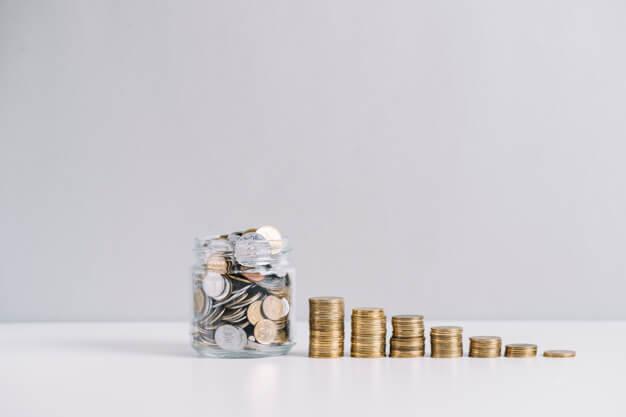 ágio e deságio pilha de moedas